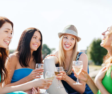 summer holidays and vacation - girls with champagne glasses on b