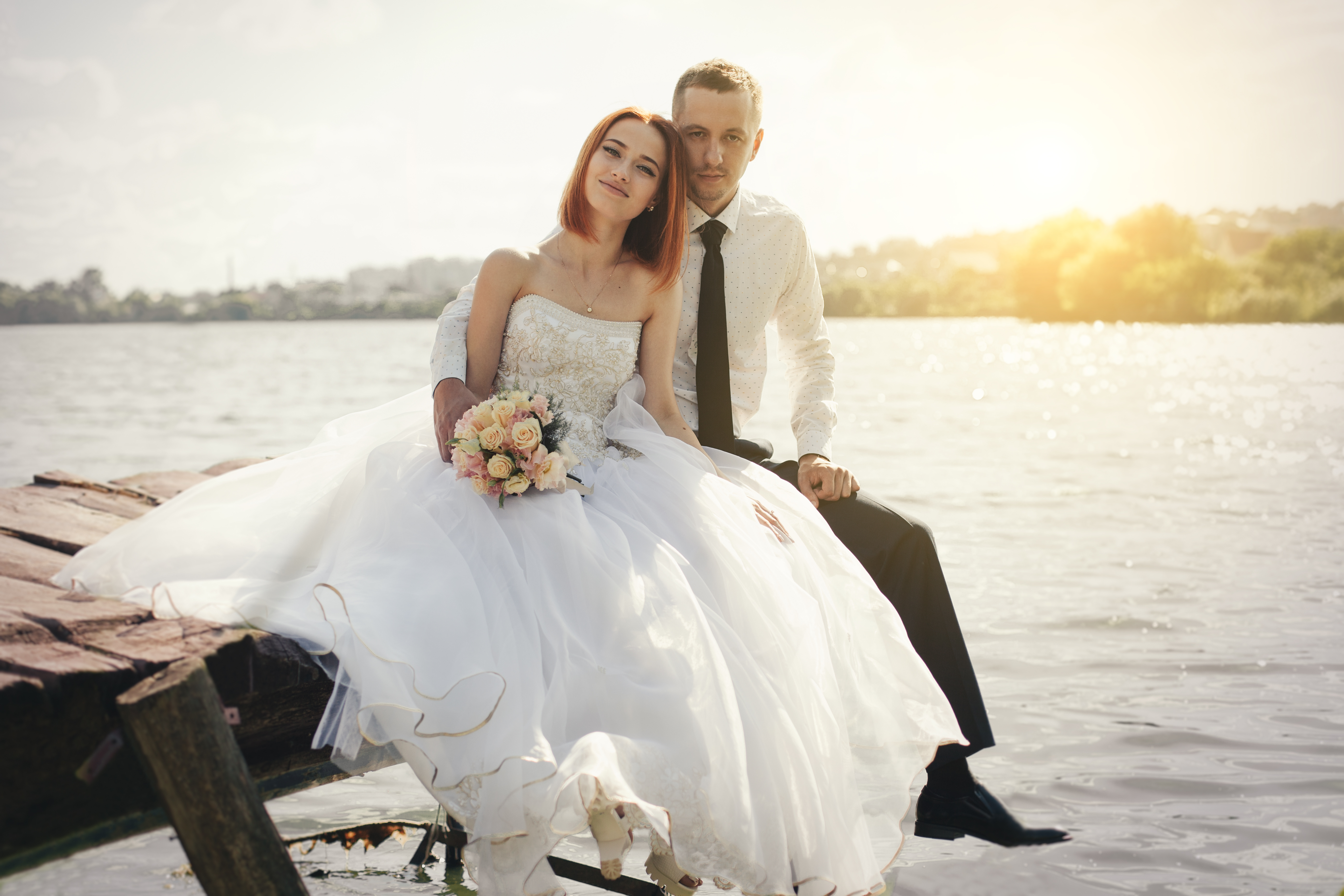 bigstock Wedding Couple Sitting On Brid 204538081